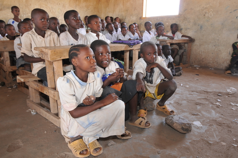 relationship between poverty and schooling