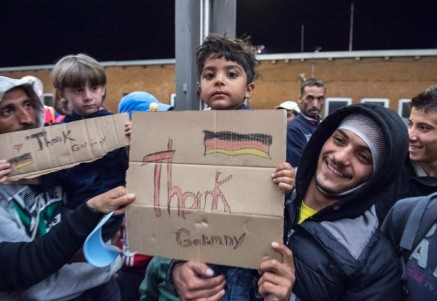 Refugees arrive at the train station in Saalfeld, Germany (Source: Jens Meyer)